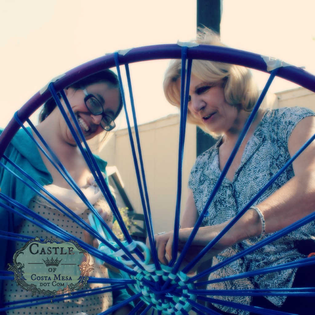 140922 Janet and Christine working on carriage wheel size hula hoop loom for weaving recycled T-shirt yarn bath rug throw 2
