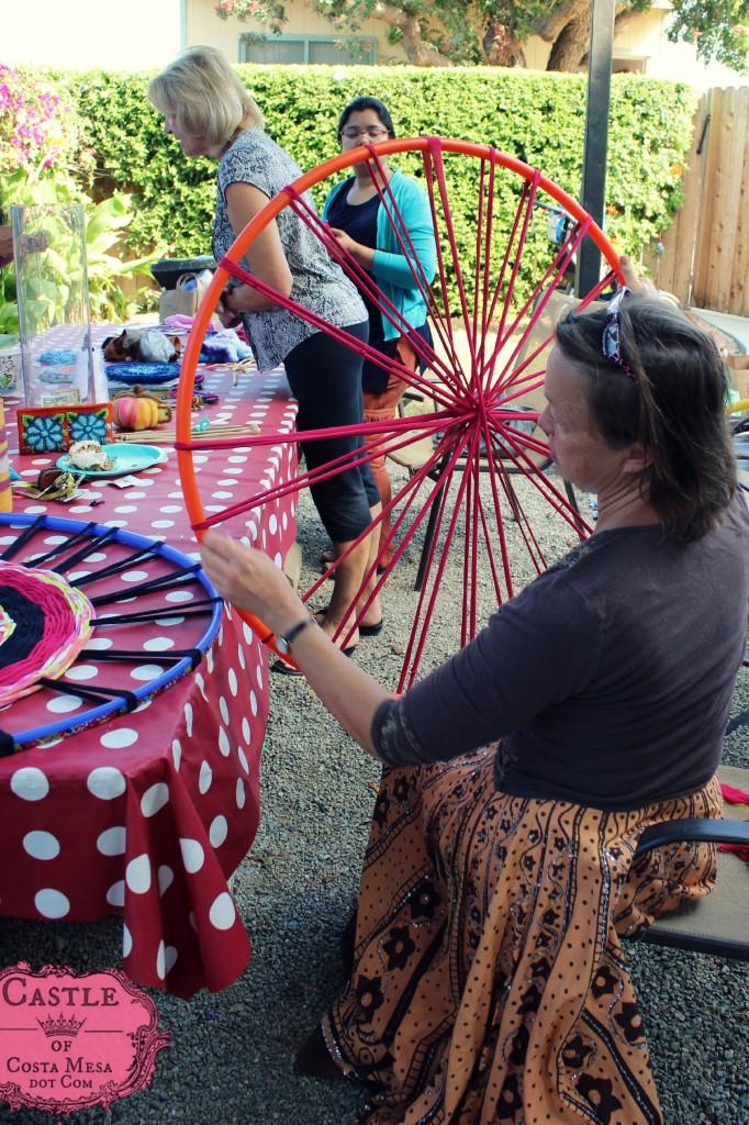 140923 Liz examining the string spokes on her hula hoop wheel loom for weaving T-shirt yarn bath rug throw 2