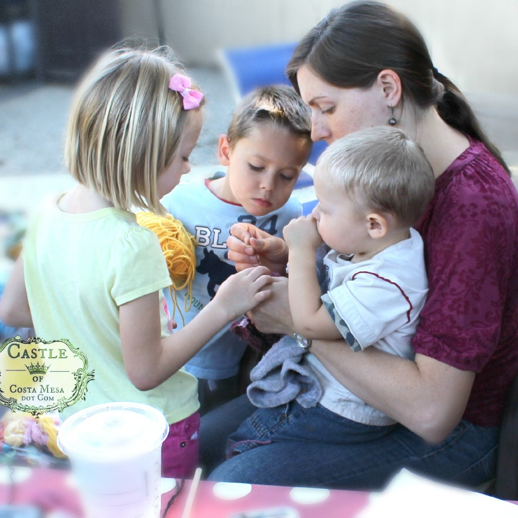141007 Laura stitching knitted cat with her constellation of children 2