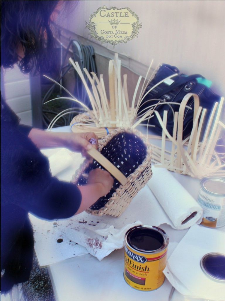 141103 Gloria varnishing her handmade woven reed wine basket with Minwax 2