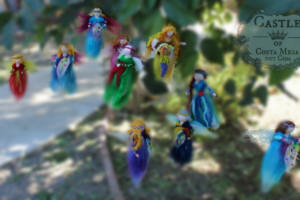 141117 10 completed wool fairy angel doll mobiles hanging in cherimoya tree 2.