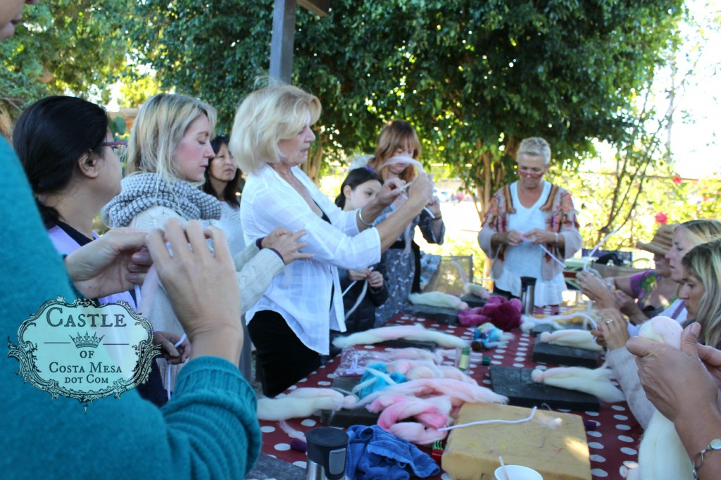 141117 Christine Newell teaching craft group to wrap wool roving for making doll hands.