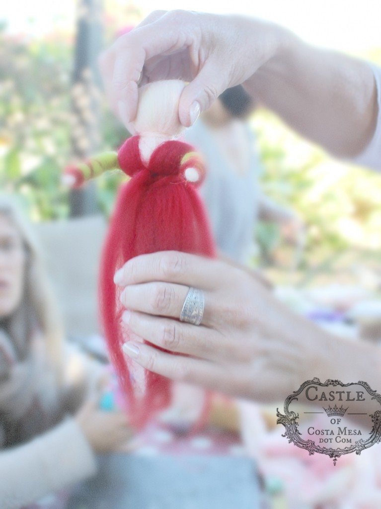 141117 Christine adding red robe and sash to her fairy doll.