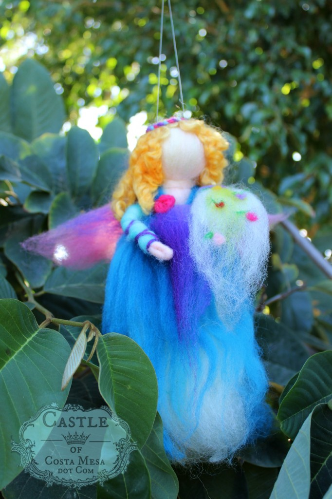 141117 Erica's blonde curly haired wool roving spring fairy mobile with cornucopia of flowers.