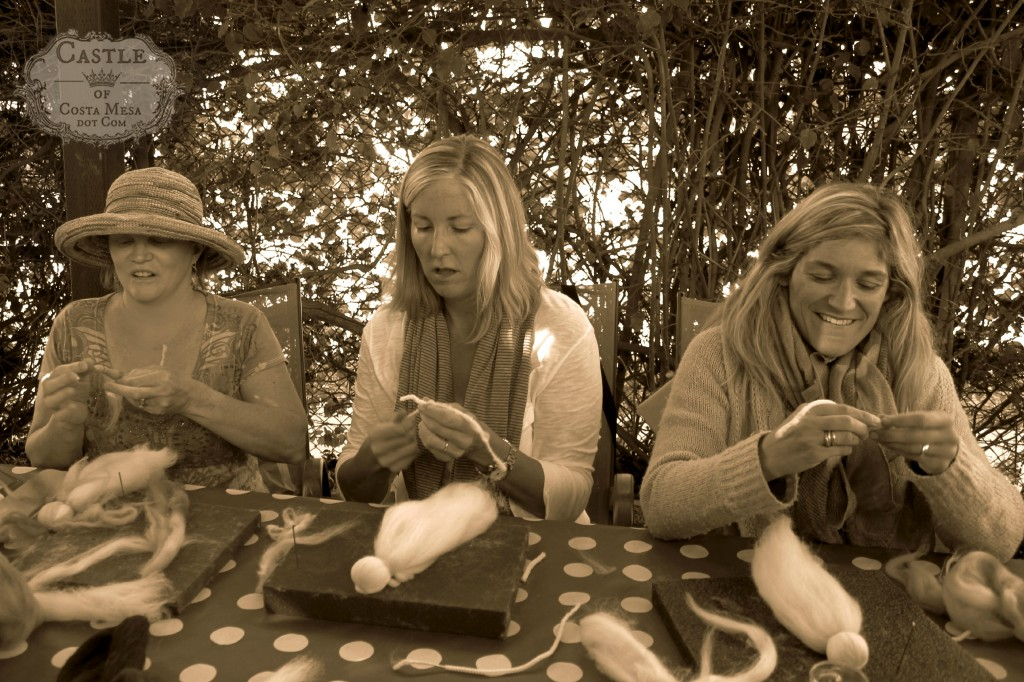 141117 Jenifer, Kathy and Tina in the grove wrapping wool fibers on pipe cleaners.