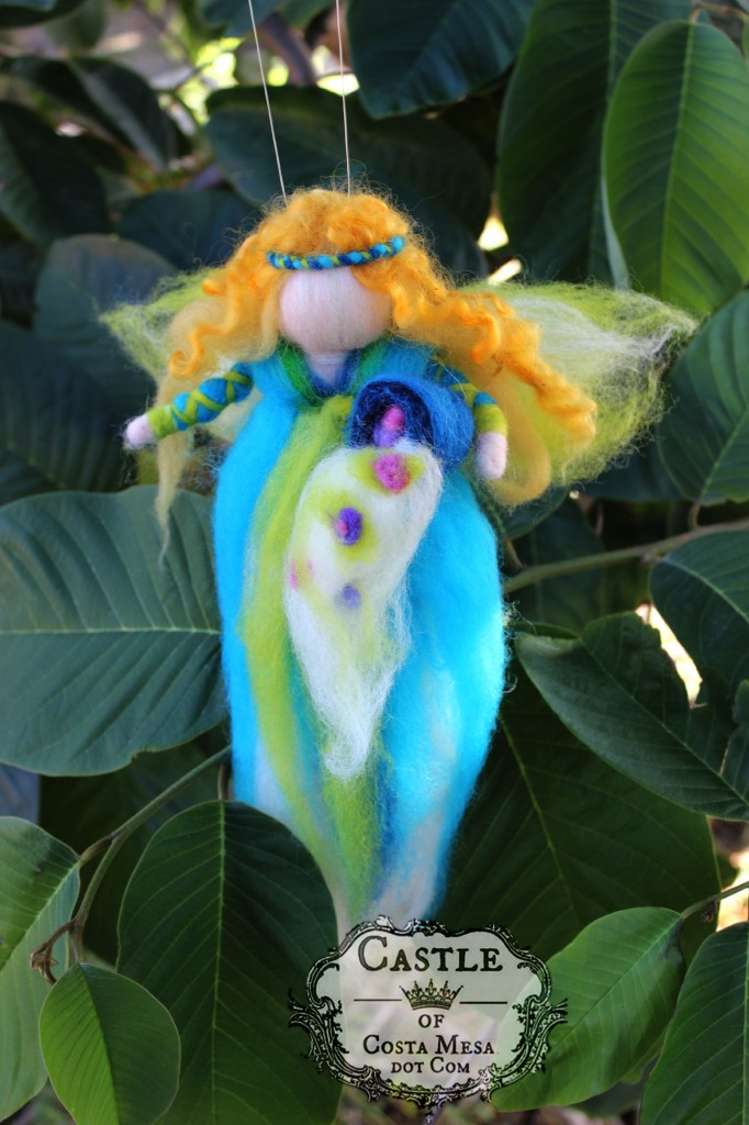 141117 Kathy's pulled wool magic fairy angel with cornucopia of plenty spewing spring flowers.