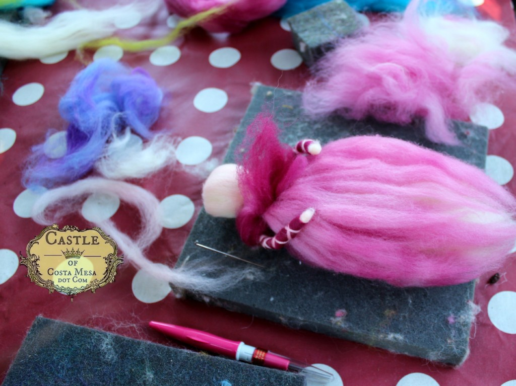 141117 Kim's fluffy pink and maroon pulled wool angel in the process of being made.