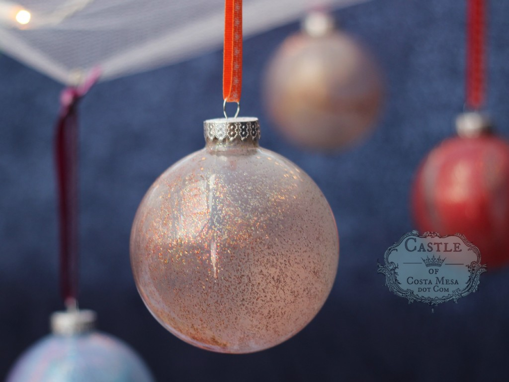 141206 festive glass balls Christmas tree ornaments hanging on ribbons.