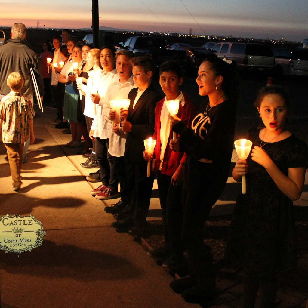141208 7th Grader choir candlelit procession  singing as Winter Festival closes.