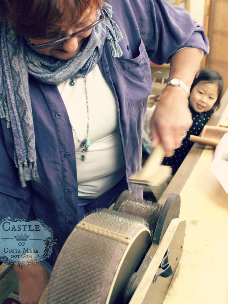 150302 Gisela cleaning brown alpaca wool from drum carder.
