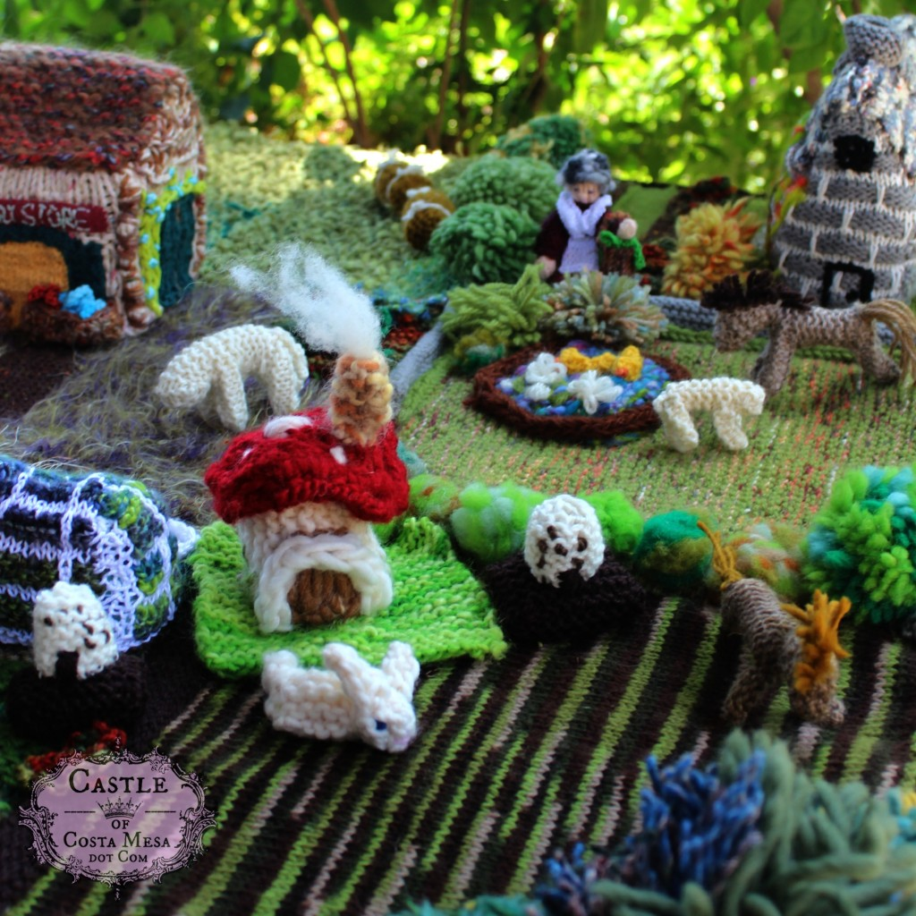 1545 150527 Nunu made knitted crochet toadstool cottage and knitted bunny.