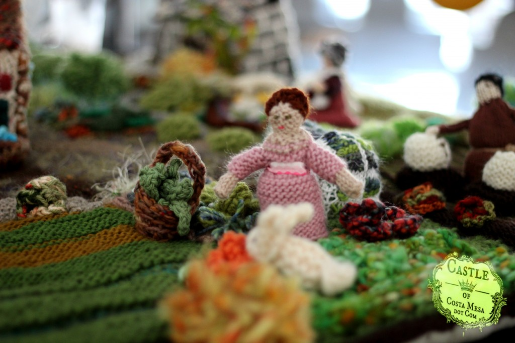 1632 150530 Knitted lady in pink in the village garden