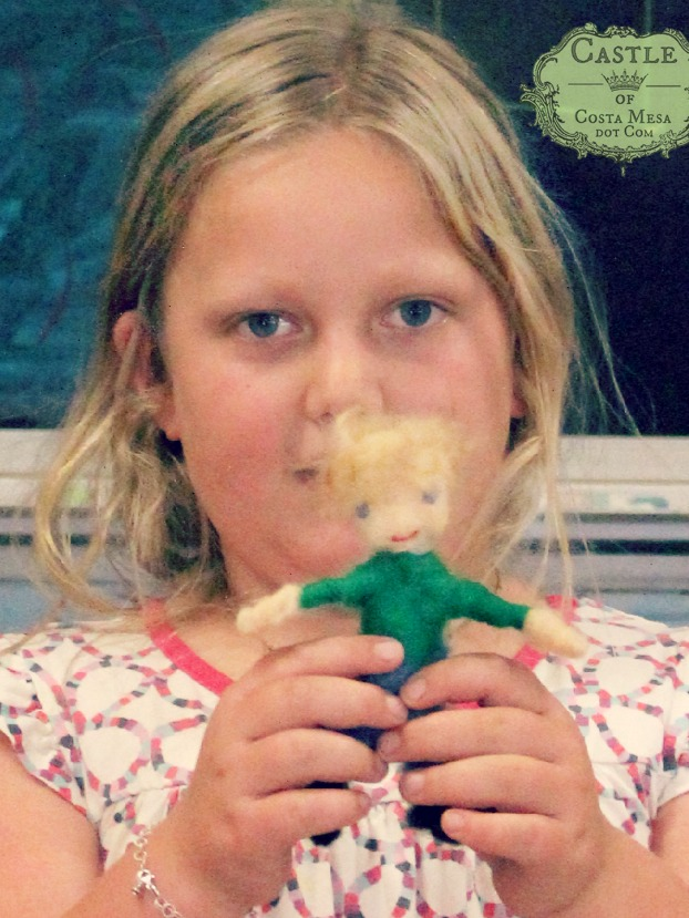 2166 150701 Kaili with her handmade needle-felted doll