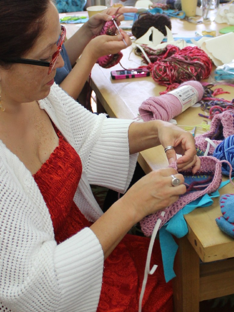 2820 150915 Geraldine threading elastic band into double crochet round at the opening of slipper