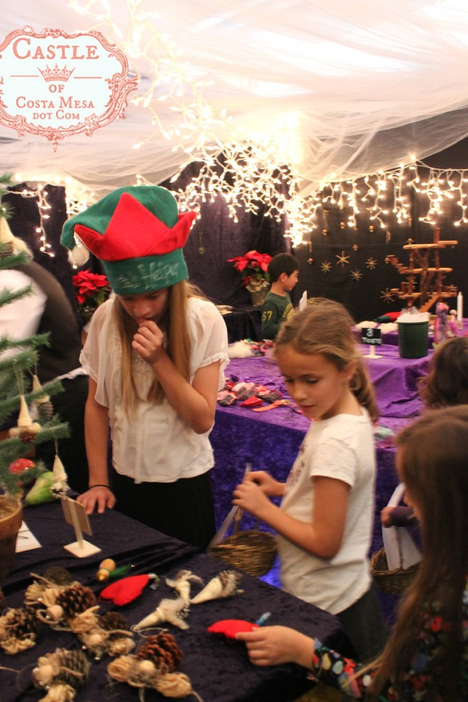 4573 151210 carefully selecting gifts while shopping at WSOC Elves Workshop